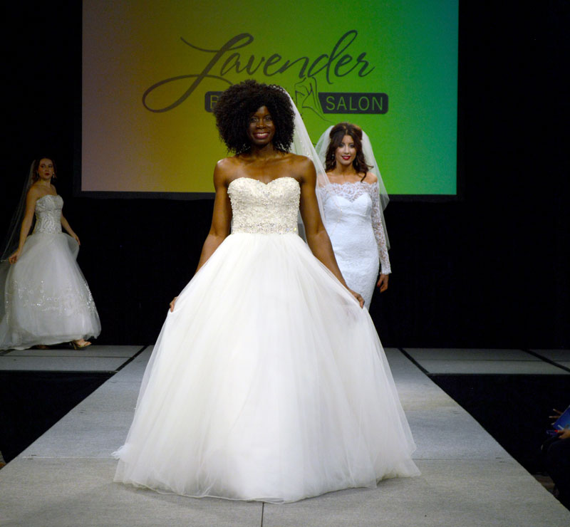 Fashion shows at the Cleveland Bridal Wedding Show. Gowns, Tuxedos, & Flowers.