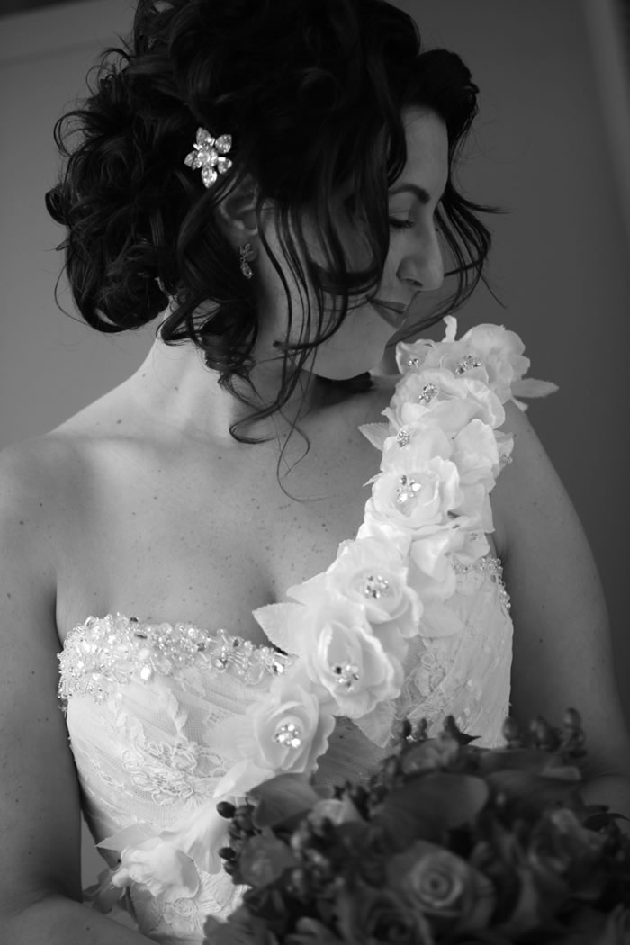 An example of a bride opting for a crystal hairpiece over a necklace for her dress. Photo courtesy of Carol Malick Photography.