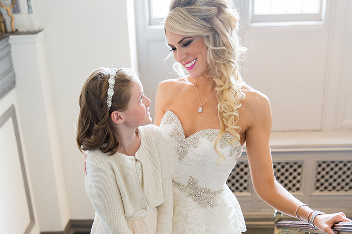 Brittany & Nicholas - Cleveland Elegance | Karen Menyhart Photography | As seen on TodaysBride.com | Cleveland Wedding Photography, Winter wedding ideas, flower girl, bridal hair, side swept bridal hair
