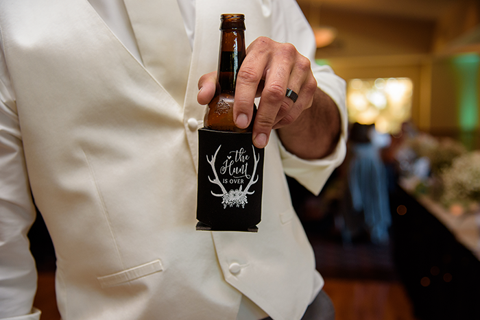 Leah & Fred - Simple Chenoweth Golf Club Wedding | Sabrina Hall Photography | Real Akron wedding as seen on Todaysbride.com, chenoweth golf club wedding, golf course wedding, ohio wedding, rustic wedding, cowgirl boots, wedding koozie