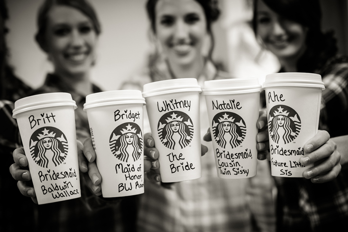 Bridesmaids holding coffee cups | Artistic Photography Inc | As seen on TodaysBride.com