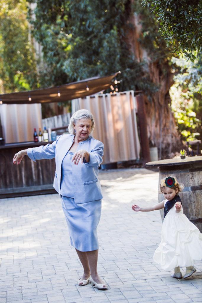 grandma teaching flower girl ballet | John Patrick Images | As seen on TodaysBride.com