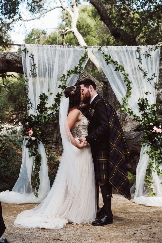 Bride and groom first kiss | John Patrick Images | As seen on TodaysBride.com