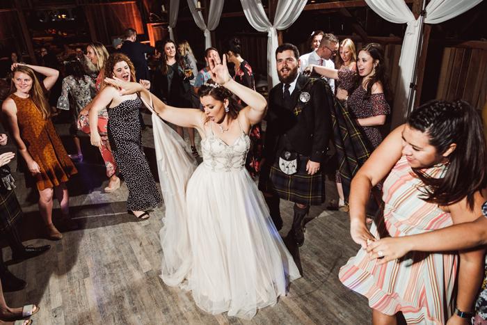 Bride dancing at wedding | John Patrick Images | As seen on TodaysBride.com
