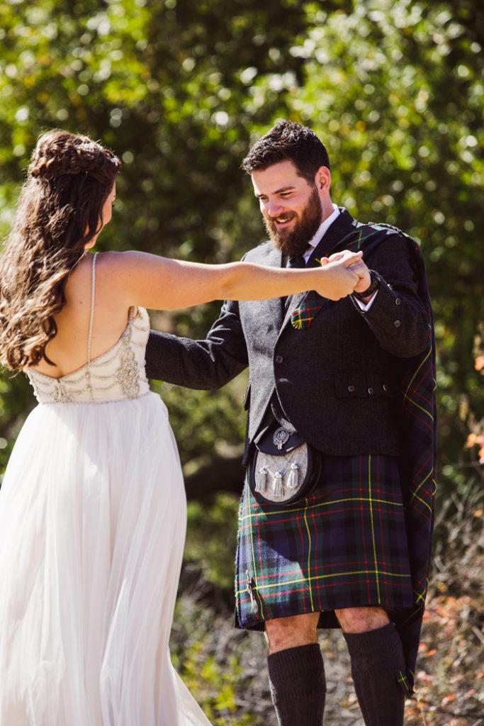groom looking at bride in wedding dress | John Patrick Images | As seen on TodaysBride.com