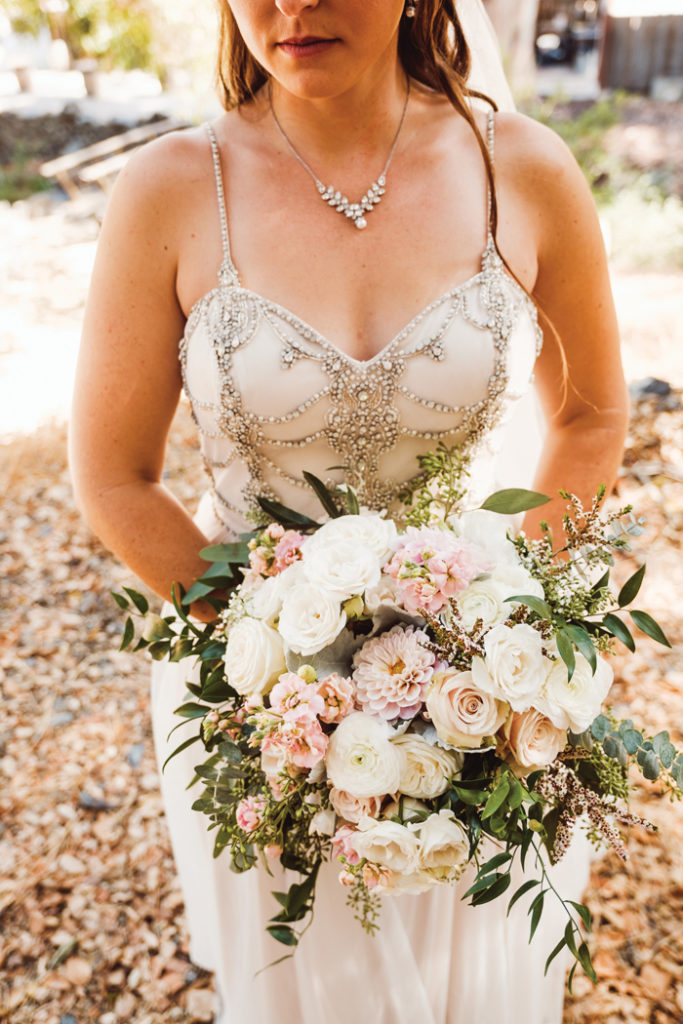 Bride holding flowers | John Patrick Images | As seen on TodaysBride.com
