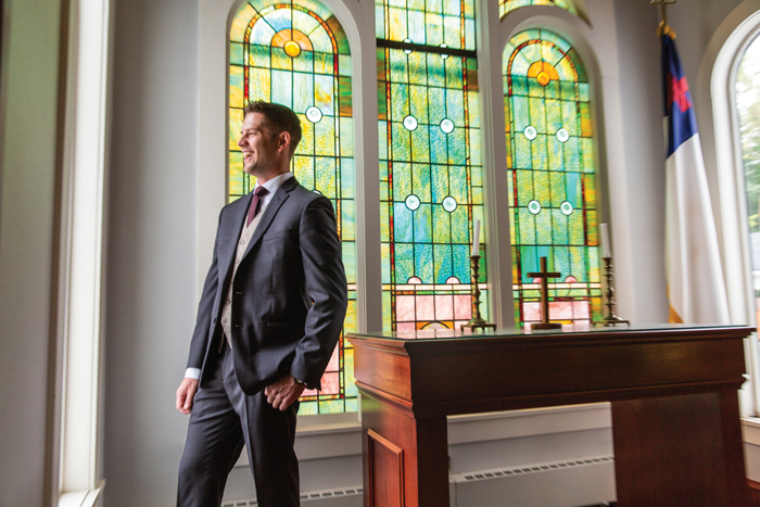 Groom in Church | The Cleveland Photographic Co. | As seen on TodaysBride.com