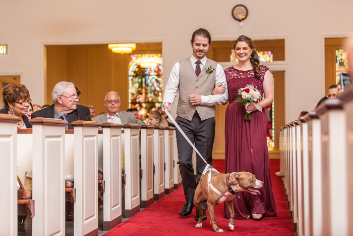 Bridesmaid and Groomsman walking Dog down the Aisle | The Cleveland Photographic Co. | As seen on TodaysBride.com