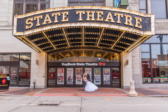 Bride and Groom Kissing in front of Theater | The Cleveland Photographic Co. | As seen on TodaysBride.com