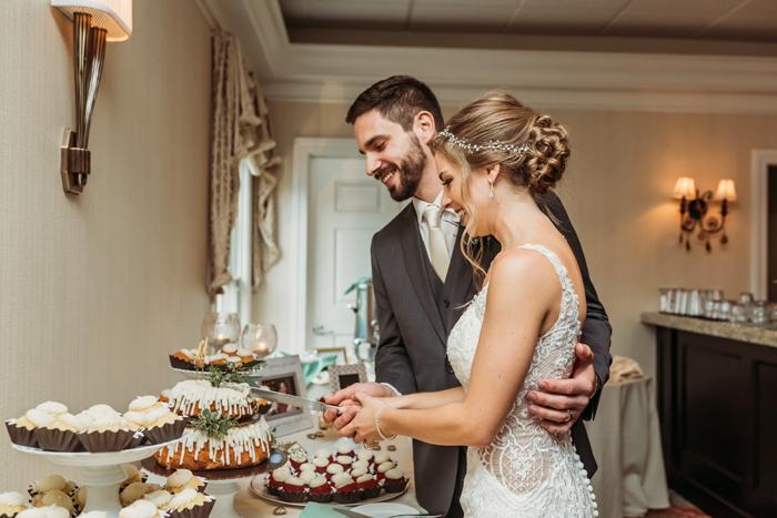 Bride and Groom Cutting Cake | Jadie Foto | As seen on TodaysBride.com