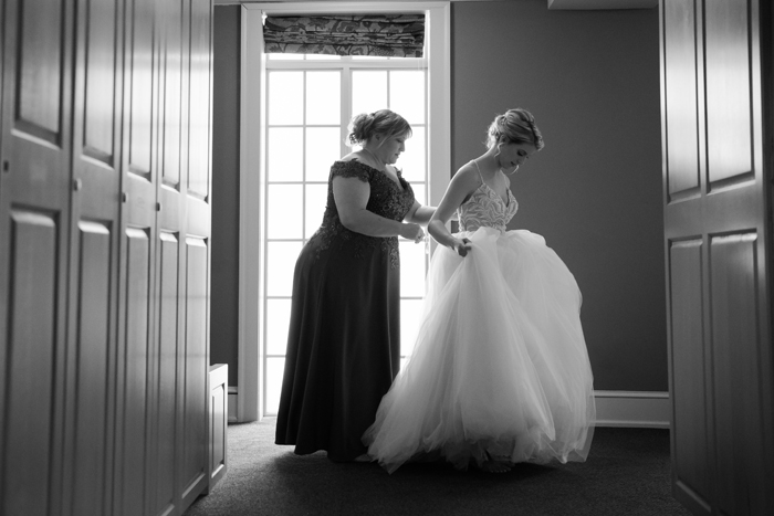Bride and her mom trying on wedding dress   Sabrina Hall Photography   As seen on TodaysBride.com