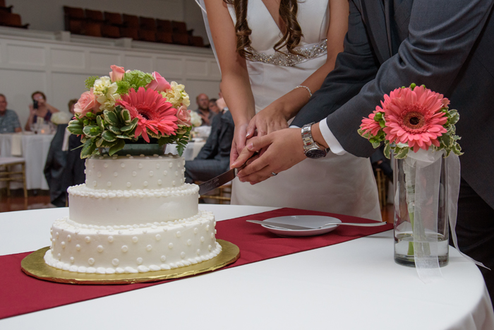 Bride and Groom cutting cake | Sabrina Hall Photography | As seen on TodaysBride.com