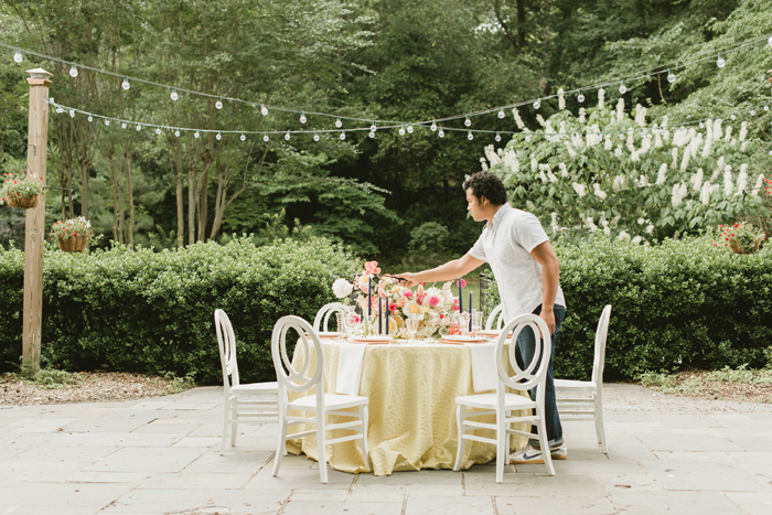 Wedding Planner Setting up Table | Shelby Rae Photography | As seen on TodaysBride.com