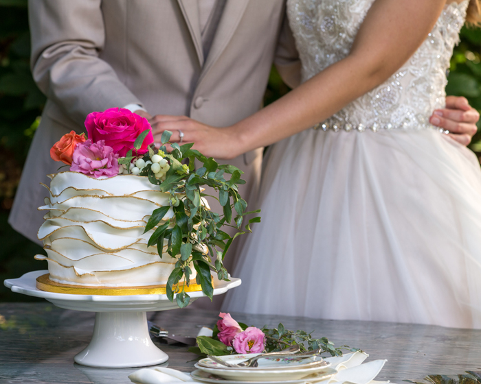 Bride and Groom cutting cake | OH Snap! Photography | As seen on TodaysBride.com