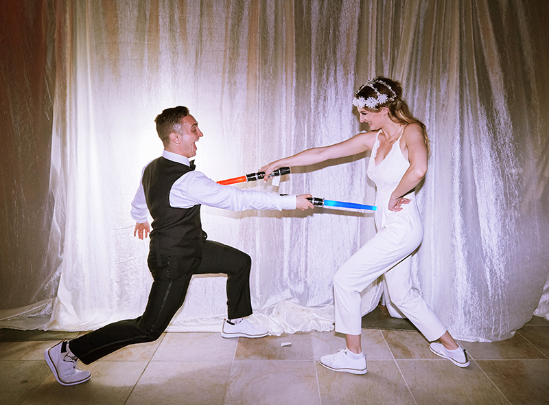 Bride and Groom Lightsaber Duel | Stephany Perea | As seen on TodaysBride.com
