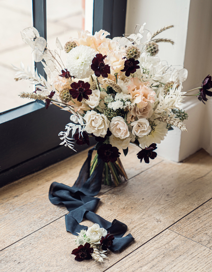 Wedding bouquet with dried flowers and ribbon