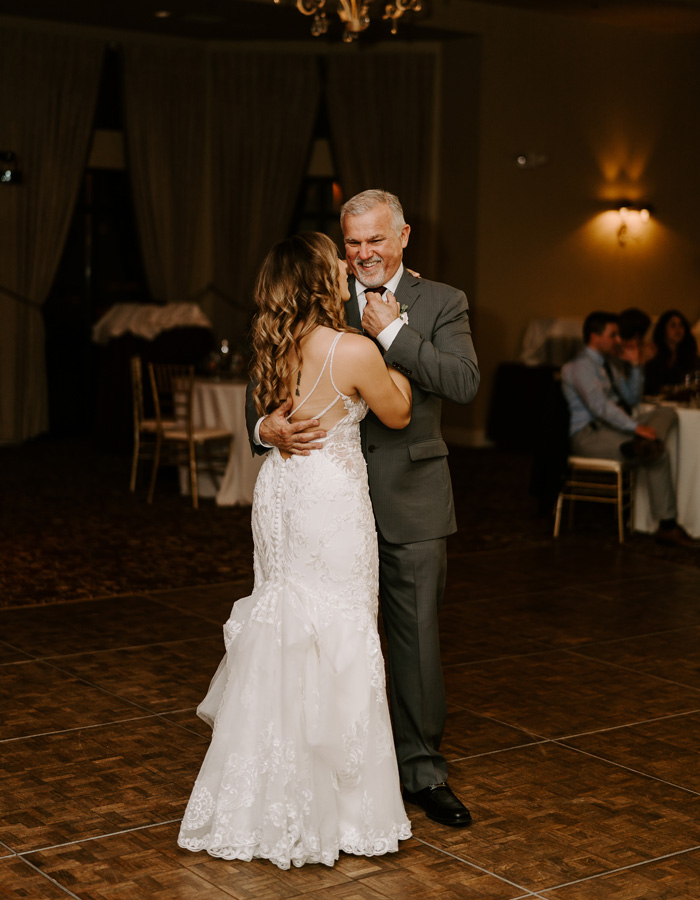 Father of the bride dancing at wedding