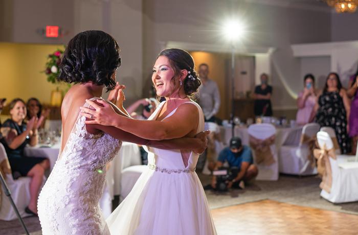 two brides dancing